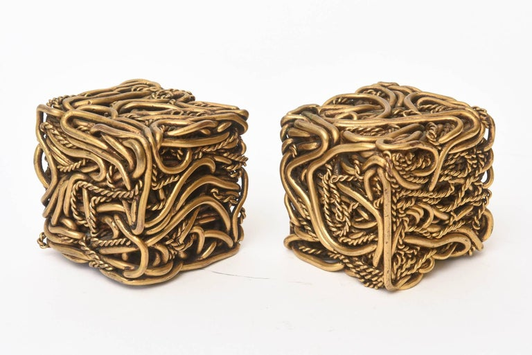 These amazing and fabulous pair of signed French bronze square cube sculptures are meticulously intertwined works of bronze braided and twisted rope giving a spaghetti like design. They were purchased in France and signed on one of them