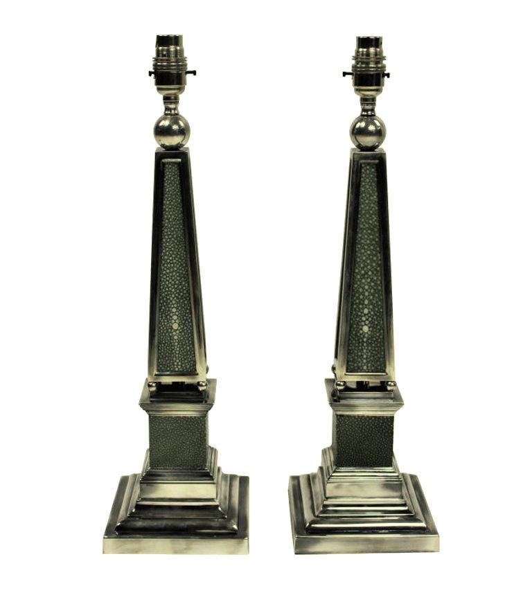 A pair of English silver plated obelisk lamps covered in antique shagreen.