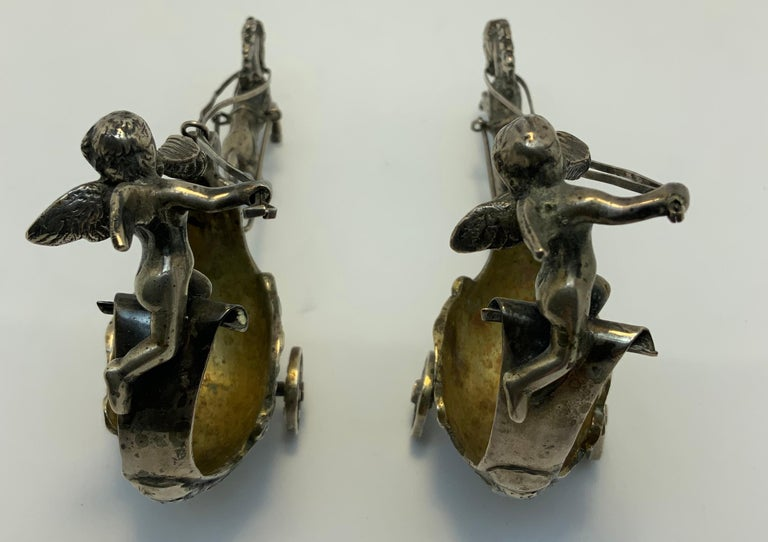 Rococo Revival Pair of Silver Chariots Driven by Winged Cherub Salt Cellars For Sale