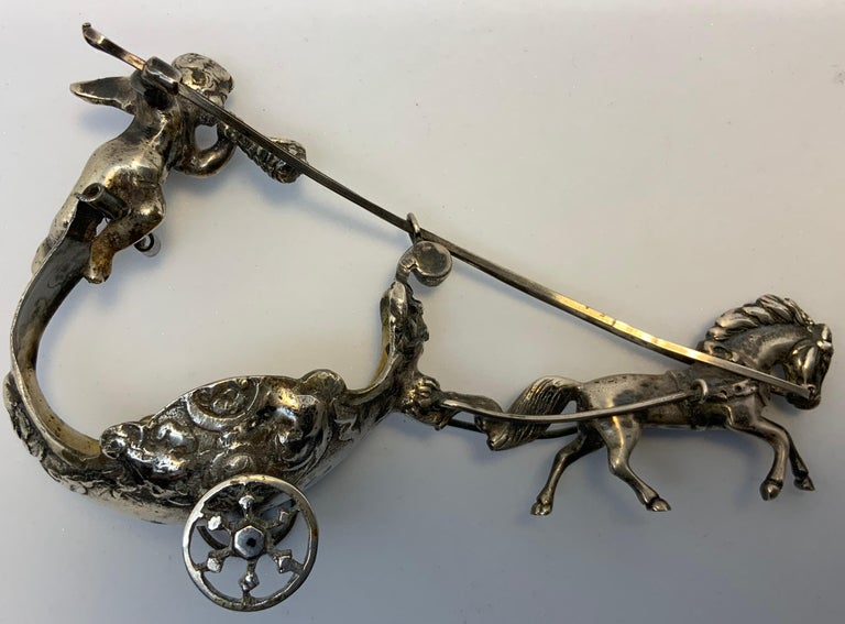 Embossed Pair of Silver Chariots Driven by Winged Cherub Salt Cellars For Sale
