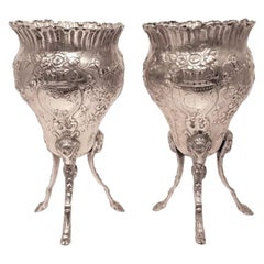 Pair of Silver Footed Vases with Flowers and Bows