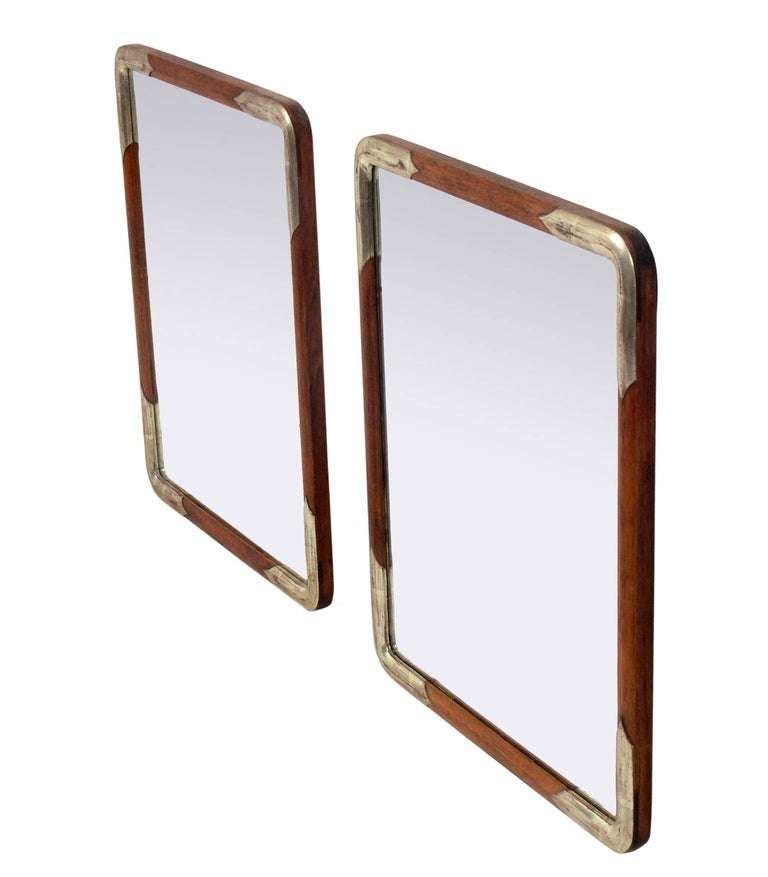 Pair of silver leafed and natural wood mirrors, Japanese, believed to be circa 1950s, possibly earlier. They retain their warm original patina.