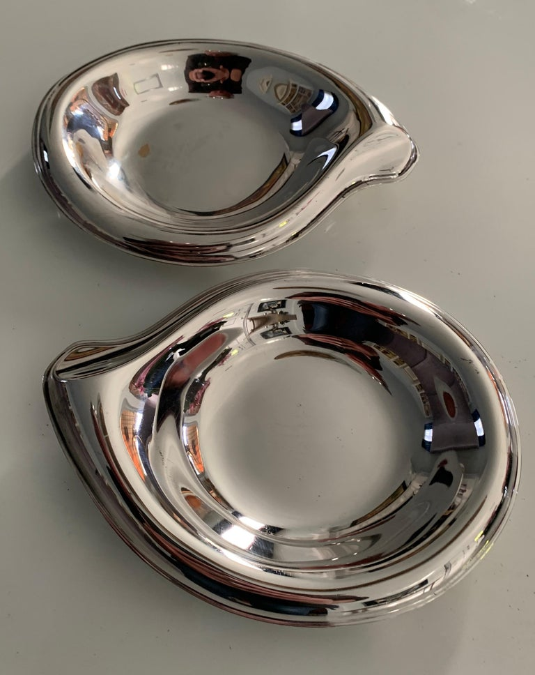 Pair of delightfully curved sliver plate dishes by Rogers, however the look is reminiscent of Elsa Peretti - organically curvaceous. Originally designed for Bon Bons, the pair well suited for the bar, for hors d'oeuvres, or for his and his soap