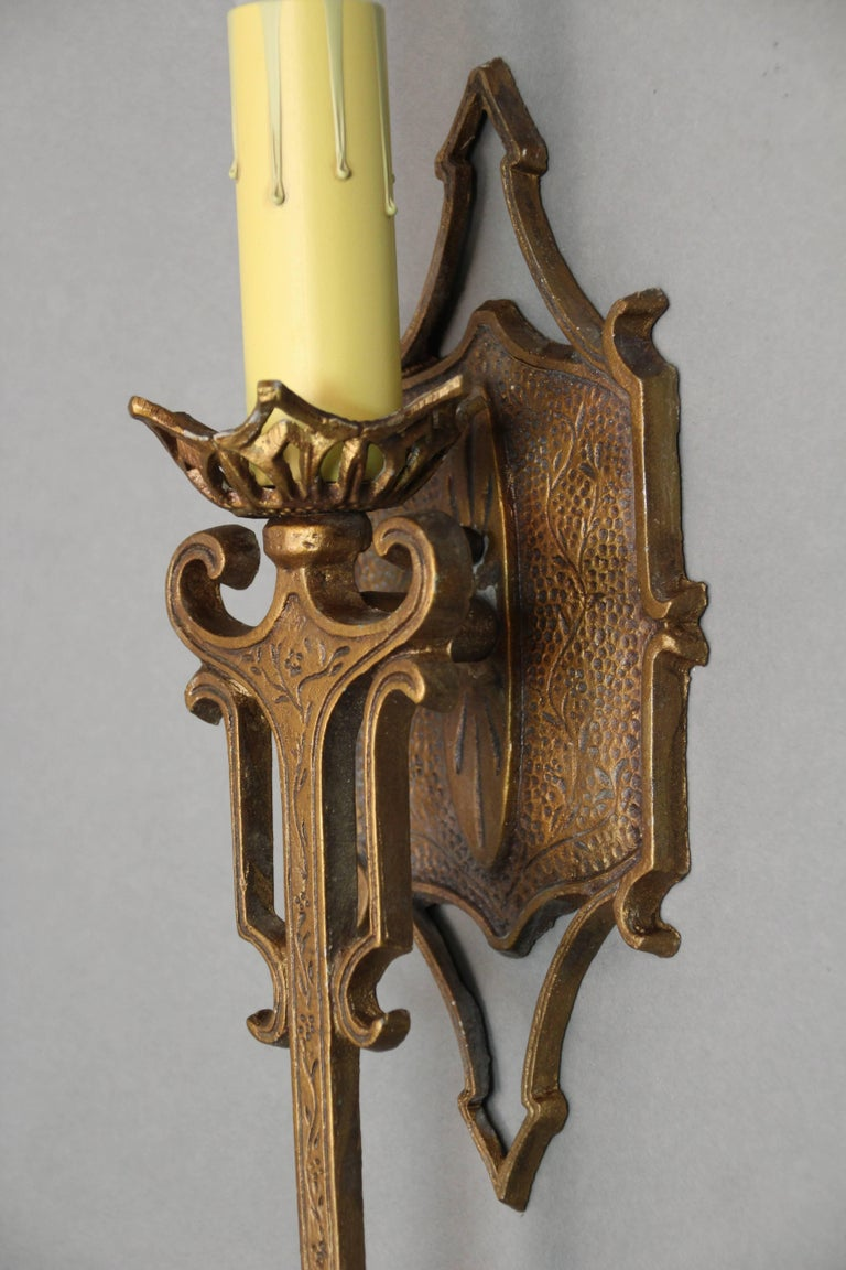 Single sconces with original gold tone finish, circa 1920s.