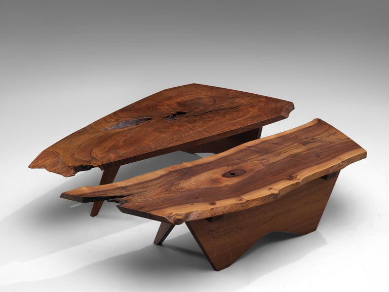 George Nakashima, two Slab coffee tables, American walnut, United States, 1960s  Two slab coffee tables made of a solid board top. The coffee tables are designed by George Nakashima to express the character of a particular slab. The first table is