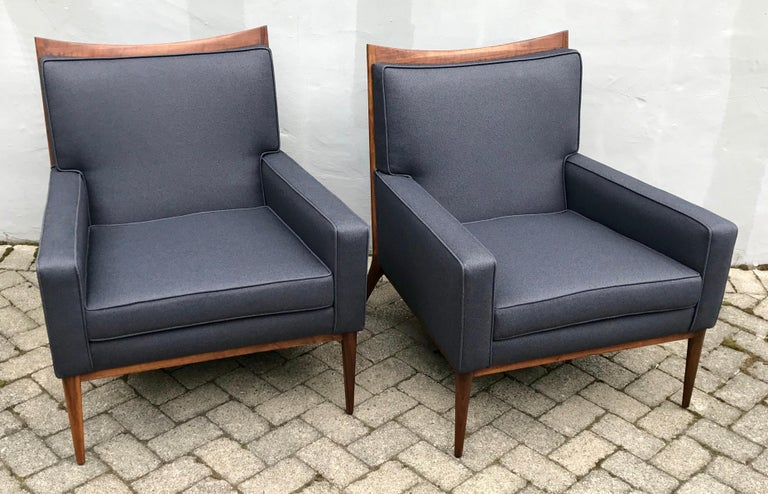 Exceptional pair of slate grey Paul McCobb club chairs for Directional, 1950s. Reupholstered in a rich slate grey fabric by Knoll Textiles, beautiful restored walnut frames, original labels.