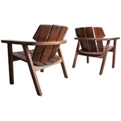 Pair of Slatted Rosewood Lounge Chairs by Sergio Rodrigues, 1950s