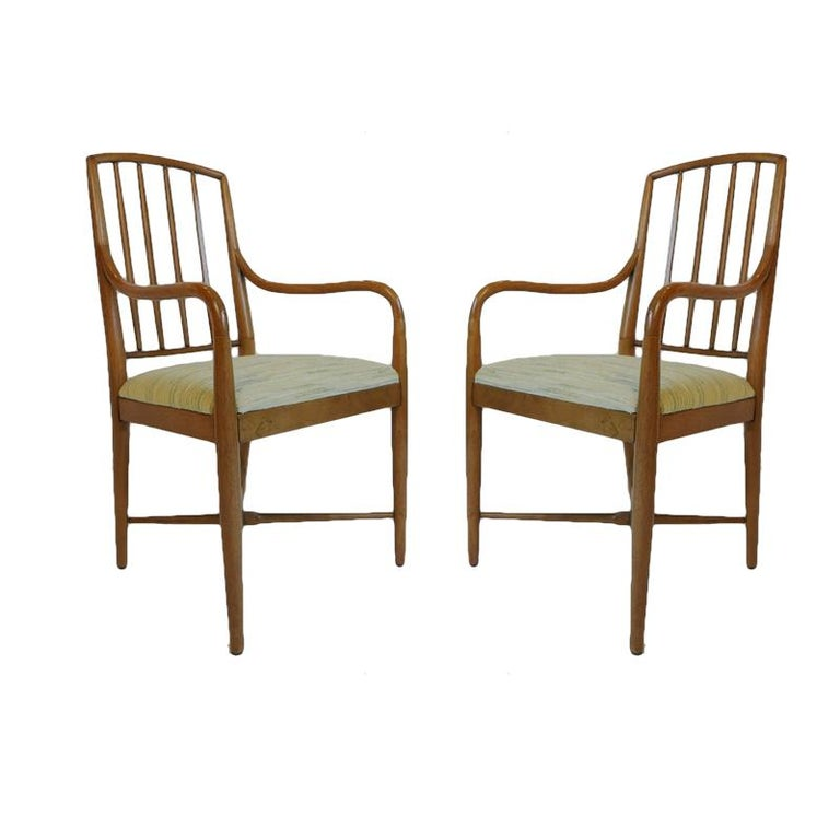 Stunning pair of Drexel armchairs from the 1960s constructed of carved fruit or nutwood with upholstered seats.