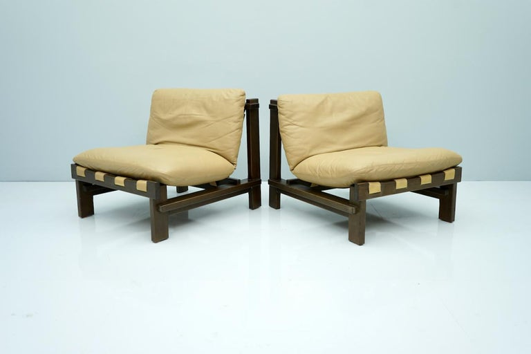Pair of slipper chairs by Carl Straub, Denmark, 1960s. Stained oak and light brown leather. Beautiful details. Good to very good condition 2 Sets are available.