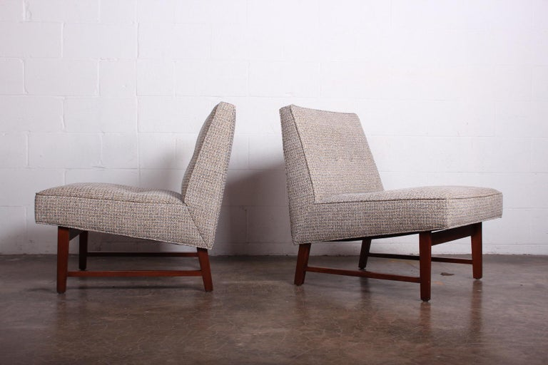 A pair of slipper chairs with mahogany bases. Designed by Edward Wormley for Dunbar.