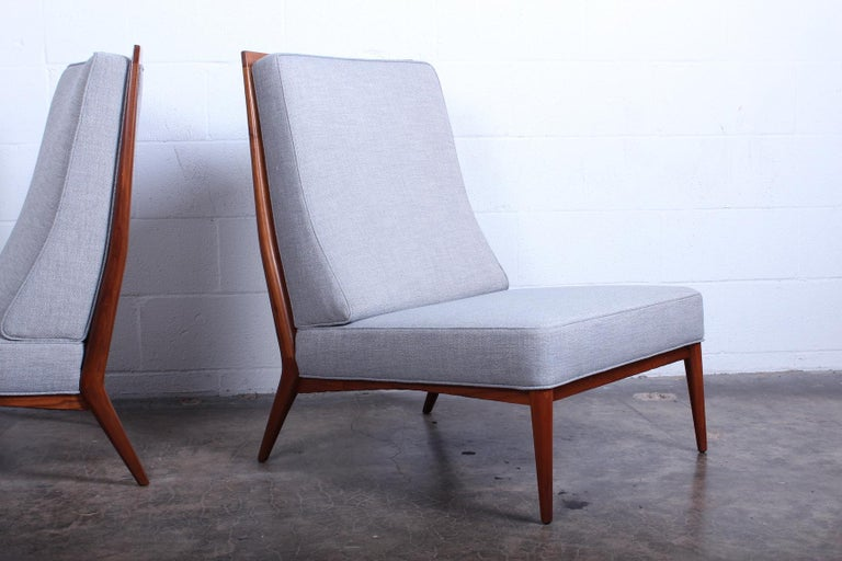 A pair of slipper chairs designed by Paul McCobb. Fully restored.