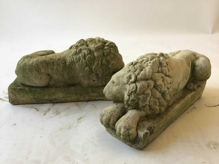 Pair of small 1960s concrete lions. Though these are a pair, both lions are in different positions.