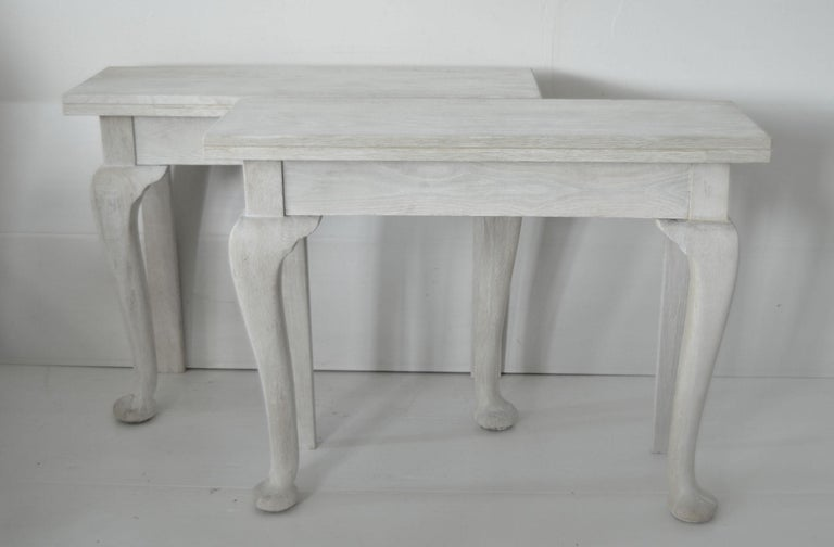 Very elegant pair of bleached oak console tables.  Wonderful simple lines  They have been adapted. They started life off as one table. Literally cut in two and replacement back legs using old material.  English, early 20th
