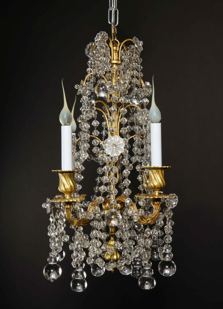 20th Century Pair of Small Antique French Louis XVI Gilt Bronze and Crystal Chandeliers For Sale