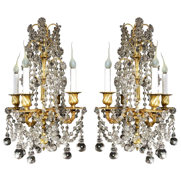Pair of Small Antique French Louis XVI Gilt Bronze and Crystal Chandeliers For Sale