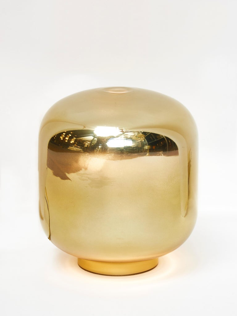 Pair of small lantern shaped table lamps in glass painted in gold.