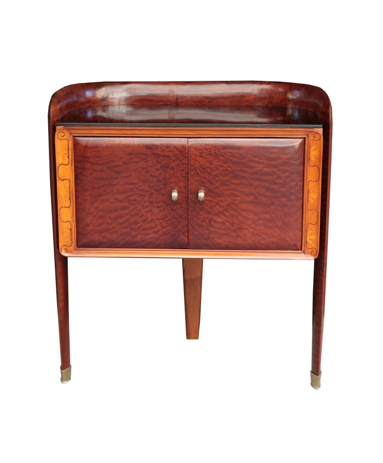 A pair of small Italian bedside cabinets. 