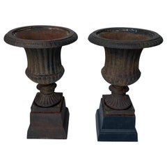 Pair of Small Late 19th Century Cast Iron Urns on Stands