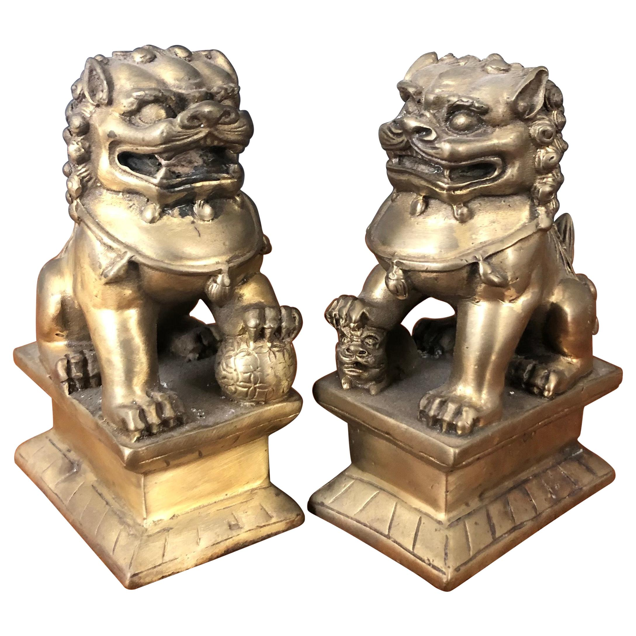 Pair of Small Patinated Bronze Chinese Foo Dogs