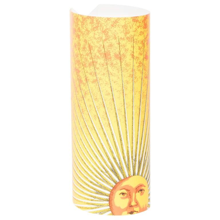 """A pair of small table lamps by Barnaba Fornasetti  """"Sole""""  Printed and colored perspex  Made by Fornasetti and Antonangeli Iluminazione.  Paderno Dugano.  Italy, 1995  Measures: 33 cm high x 12 cm wide x 16 cm deep."""