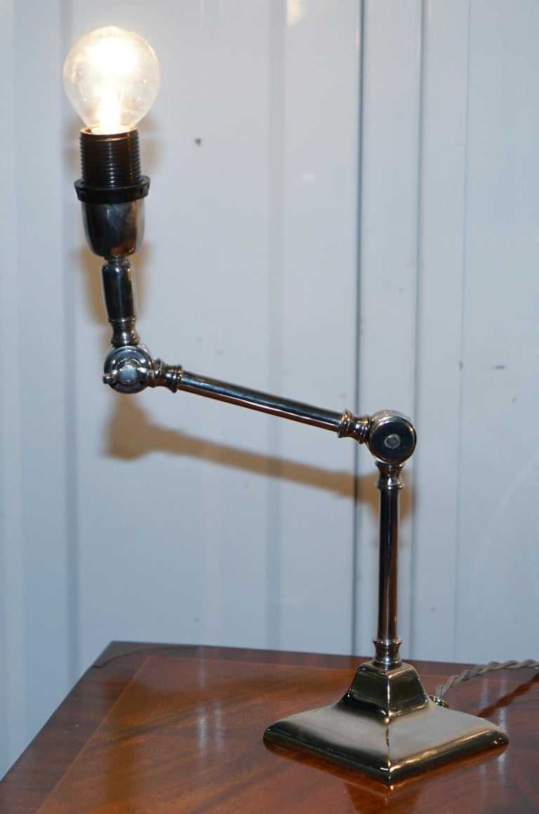 English Pair of Small Solid Polished Metal Table Lamps with Two Points of Articulation For Sale
