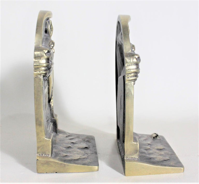 Mid-Century Modern Pair of Solid Cast Brass Mid Century Era Horse Related Bookends For Sale