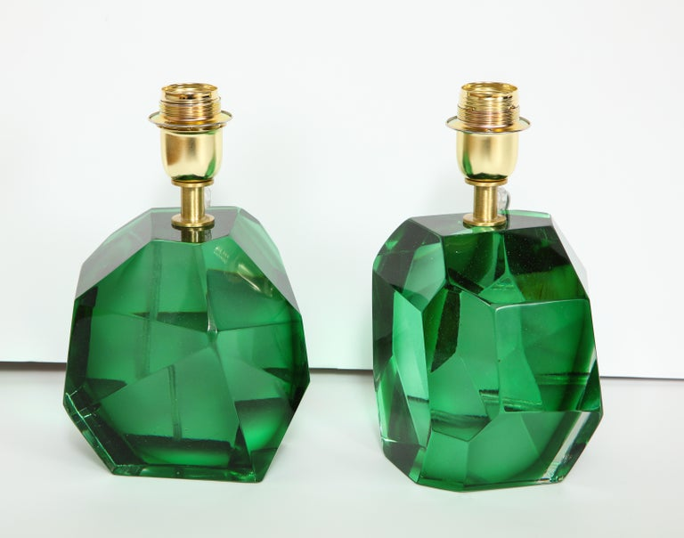 Unique pair of solid faceted Murano glass table lamps in a vibrant emerald green color with a gold tone/brass armature heavy and solid. Made by hand in Murano, Italy, by the Master Glass Maker, Alberto Dona. Signed. Wired for U.S. use. Height of 10