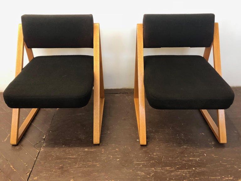 Pair of French modernist lounge or side chairs with wool fabric upholstery and solid oak triangular frames.