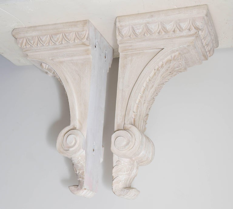 Pair of carved wood architectural wall brackets.