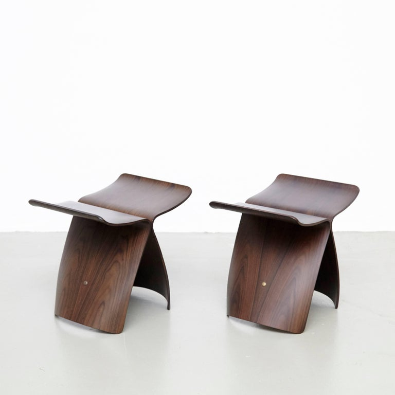 Pair of butterfly stools designed by Sori Yanagi. Manufactured by Tendo Mokko (Japan) in 1954.  In good original condition with minor wear consistent with age and use, preserving a beautiful patina.  Sori Yanagi, born in 1915 in Tokyo, attended