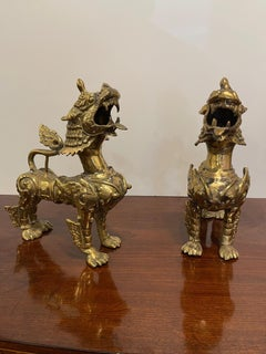 Pair of Southeast Asian Solid Brass Foo or Temple Dogs, 20th Century