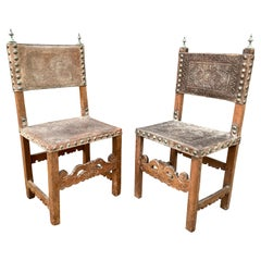 Pair of Spanish Baroque Embossed Leather Side Chairs