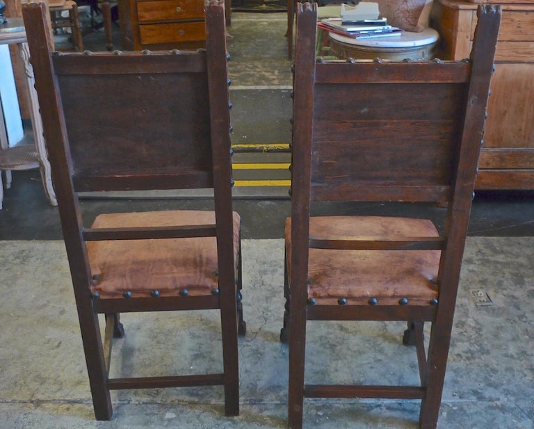 Pair of Spanish 18th Century High Back Studded Leather Dining Chairs In Distressed Condition For Sale In Santa Monica, CA