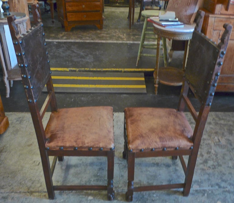 19th Century Pair of Spanish 18th Century High Back Studded Leather Dining Chairs For Sale
