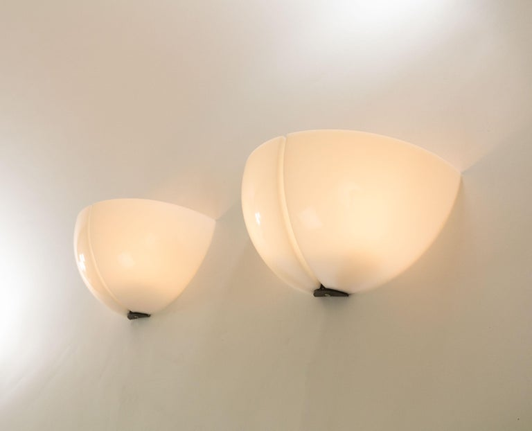 A pair of Spicchiowall lamps designed by Danilo and Corrado Aroldi and manufactured by Stilnovo in 1972.  Danilo and Corrado Aroldi designed a whole range of Spicchio lamps for Stilnovo. In our archive we found 3 different wall lamps, 2 pendants,