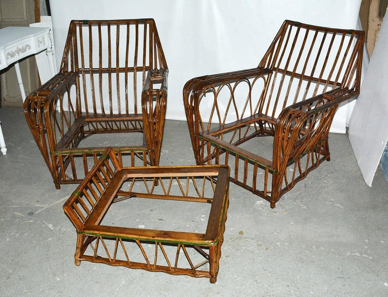 3-piece split reed seating set -- two club chairs & matching ottoman. This 1920s split reed set has been restored with a fresh coat of stain and varnish. The set would be perfect for porch, patio or family room.