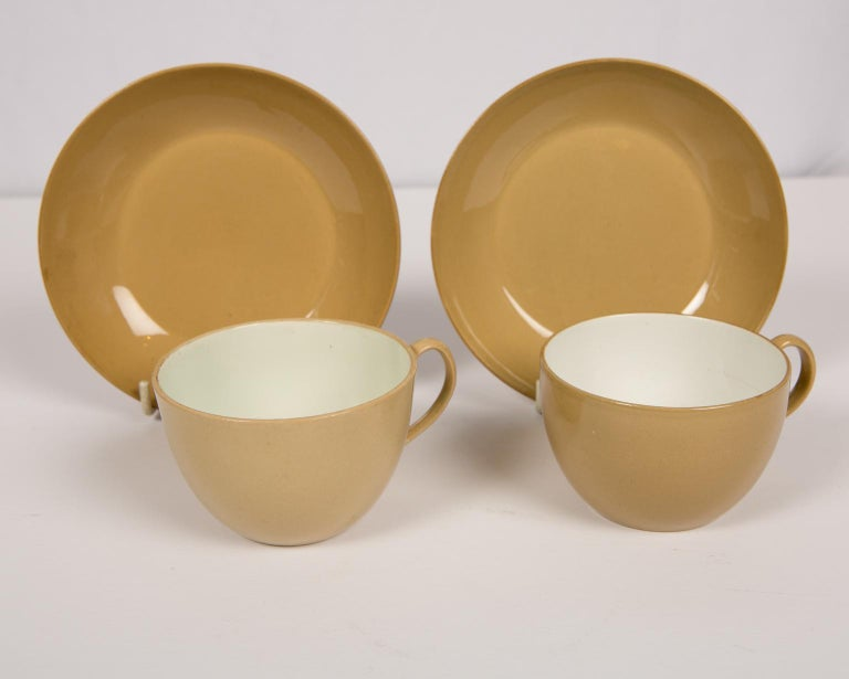 A pair of Spode drabware cups and saucers dated circa 1810. Drabware is made with dark clay as compared with other colored earthenware's, which are made with a white body and then tinted with glazes. Drabware colors vary from light taupe to dark