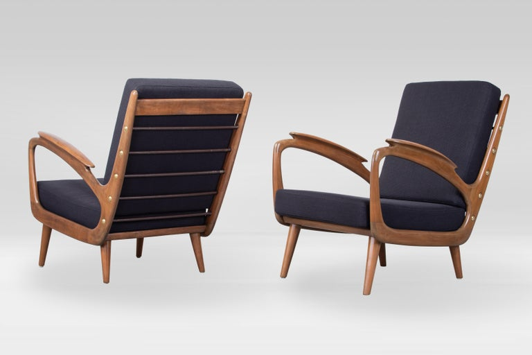 Sleek and organic carved midcentury armchair by Sprij Vlaardingen, Netherlands 1950s, cherrywood, upholstered in C&C dark blue cotton fabric.