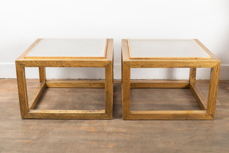 Pair of oak tables with gilded framed glass top.  The glass top is custom made to imitate rock crystal. France, circa 1970.  Measures: Height 16.3 inches (41.5 cm) Width 23.6 inches (60 cm) Depth 23.6 inches (60 cm).