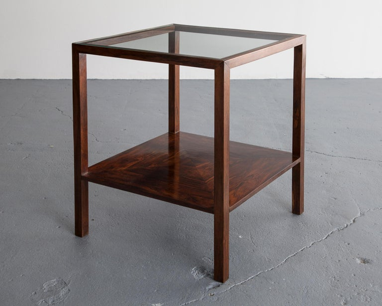 Pair of square side tables in rosewood with glass tops. Designed by Joaquim Tenreiro, Brazil, 1950s.