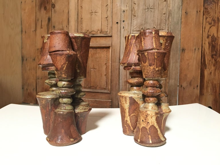 Pair of brutal ceramic candle sticks.  In 1960 he set up his own workshop in Forest Hill, London, Progressive designs were readily accepted in London at that time, and Rooke applied his efforts to making pieces of a sculptural nature. The early