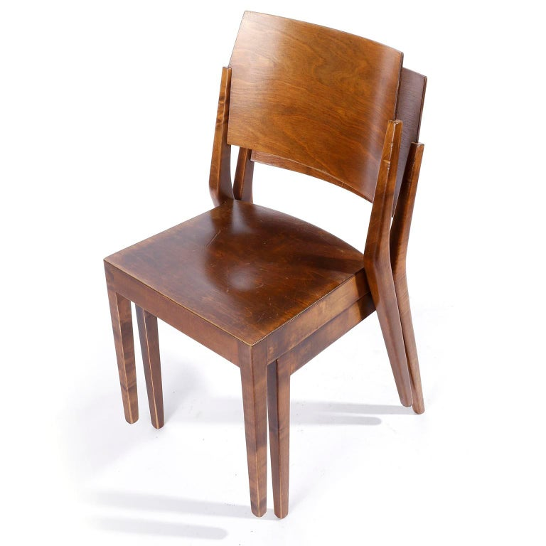 A rare set of two Viennese stacking chairs made of brown stained wood designed by Austrian architect Prof. Karl Schwanzer and manufactured by Thonet in the 1950s. This chair was designed by Karl Schwanzer for the Werkbundausstellung in the