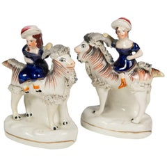 Pair Staffordshire Figures of Children Riding Goats circa 1880
