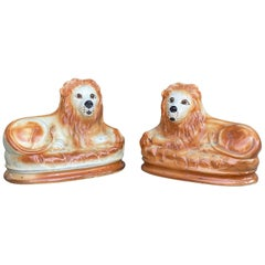 Pair of Staffordshire Pottery Lions