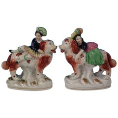 Pair of Staffordshire Royal Children on Spaniels