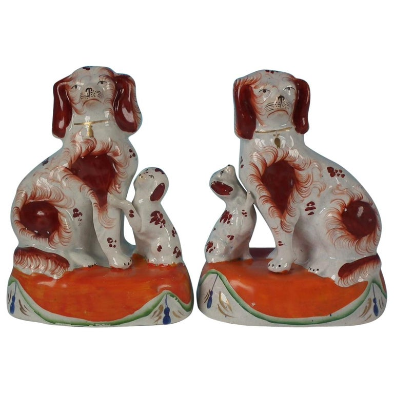 Pair of Staffordshire Spaniels with Pups on Cushions For Sale