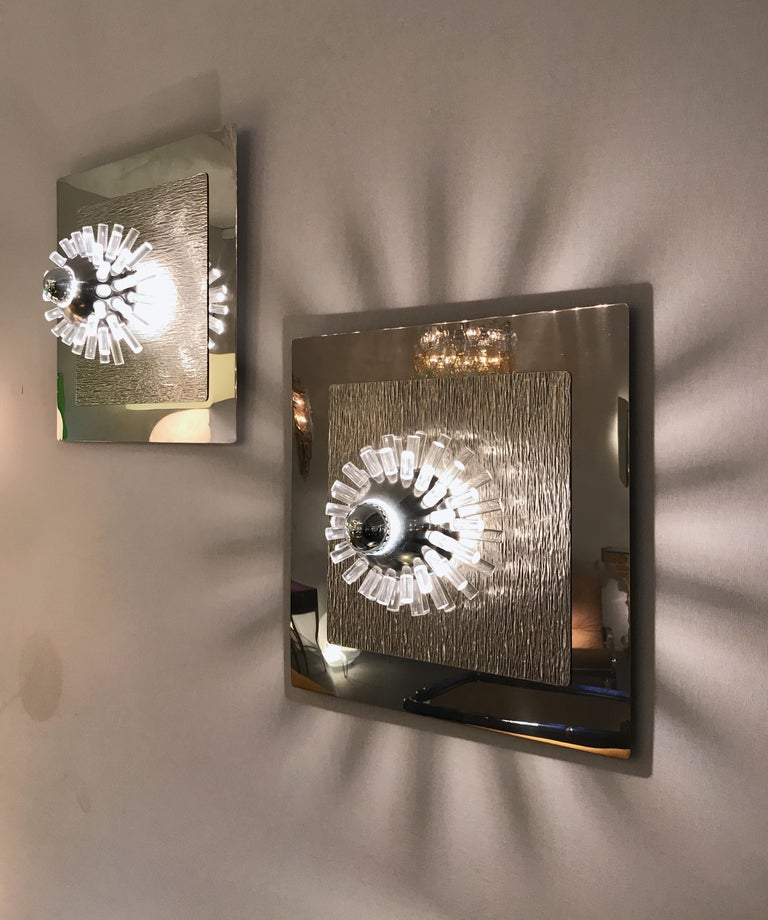 Rare large pair of wall lights sconces panel in polished and hammered stainless steel with metal ball and Lucite rods that diffuses light by the designer Angelo Brotto for the manufacture Esperia. A really Space Age work, famous design like