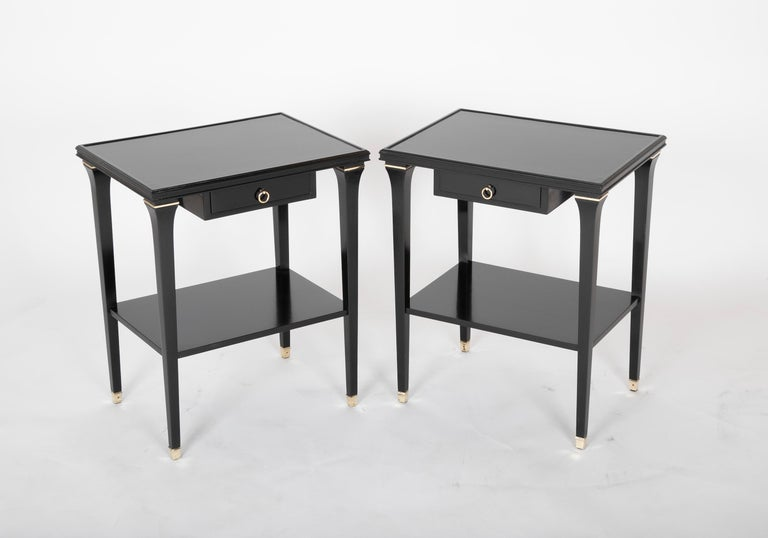 Pair of ebonized oak side tables by stamped Jansen. Finished on four sides.