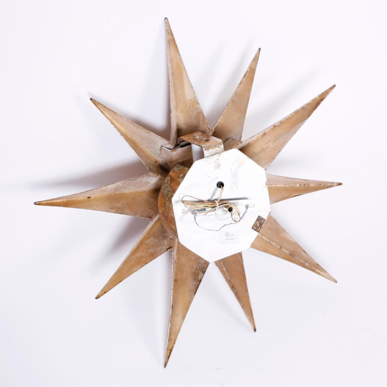 Aluminum Pair of Star Wall Sconces For Sale