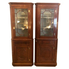 Pair of Stately Chippendale Style Mahogany and Glass Doored Corner Cabinets